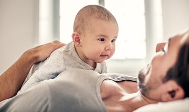 BABYBJÖRN Magazine – In baby's first year, their neck gets stronger and their senses develop.
