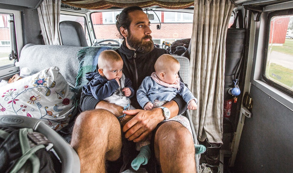 BABYBJÖRN Magazine for Parents – Dad Christian waits in the camper van with the twins.