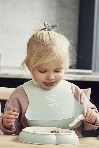 Baby Bib 2-pack in Powder Green and Powder Pink - BABYBJÖRN