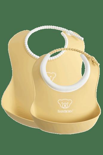 Feeding Bib set in 2 sizes, Powder Yellow - BABYBJÖRN