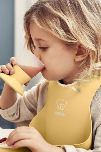 Baby Bib in Powder Yellow - BABYBJÖRN